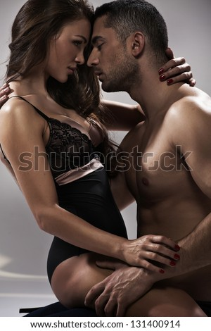 Happy young couple  in sexual intercourse - stock photo