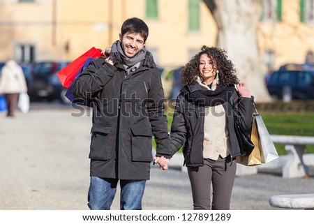 Happy Young Couple in the City Doing Shopping