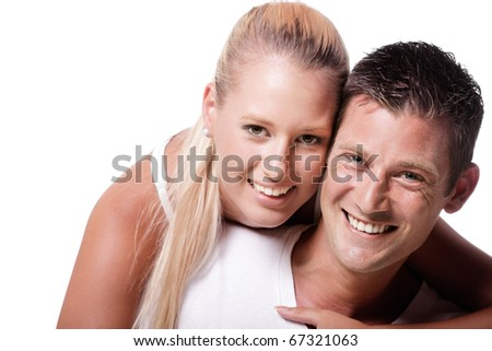 Happy young couple. Isolated over white background.