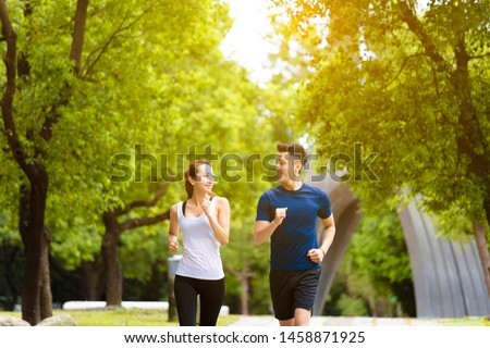 happy young Couple jogging and running  in park