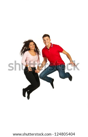 Happy young couple jumping and holding their hands isolated on white background