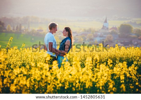 Happy young couple kissing in nature. Romantic date photo, white edit space #1452805631