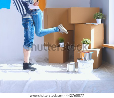 Happy young couple moving in new house Сток-фото ©