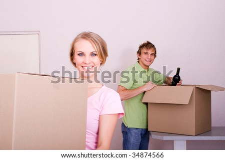 happy young couple moving to new home