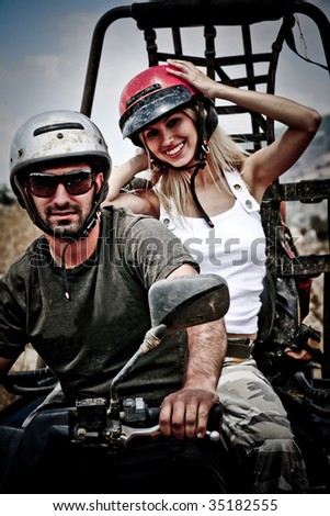 Happy young couple on ATV