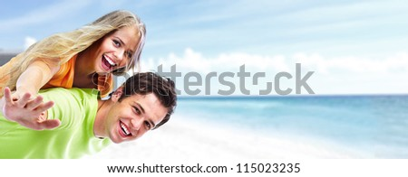 Happy young couple on the beach. Summer vacation.