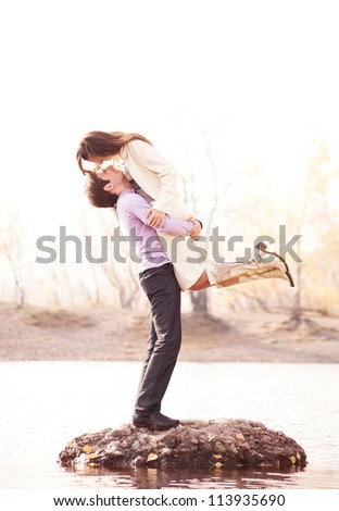 happy young couple  outdoor in the autumn park - stock photo