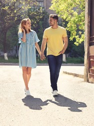 Happy young couple outdoors on sunny day