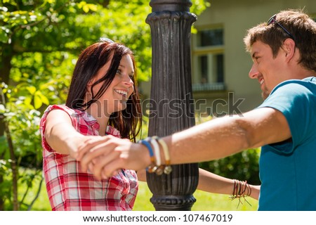 Happy young couple smiling at each other with love