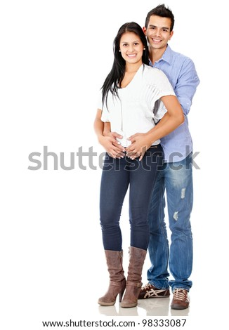 Happy young couple smiling - isolated over a white background