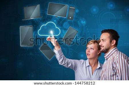 Happy young couple touching cloud service