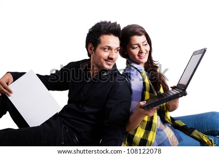 happy young couple using laptop isolated on white, multi ethnic couple isolated on white