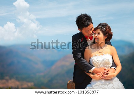 Happy young couple with mountain backgrond