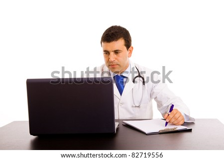 Happy young doctor working on a laptop against white background