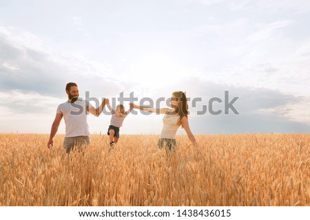 Happy young family enjoy time together outside. Mom, dad and little baby son rest outdoors.  togetherness, love, happiness concept #1438436015