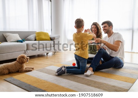 Happy young family having fun together at home. Happy childhood concept