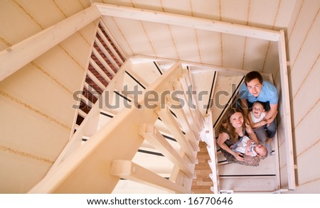 Happy young family of four at their home