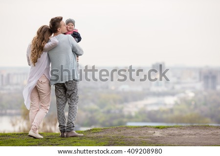Happy young family on a background of the city