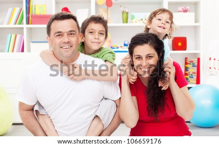 Happy young family portrait with two kids