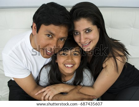 Happy young family sitting on sofa. #687435607