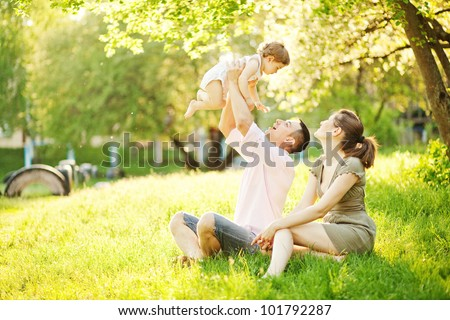 Shutterstock happy young family spending time outdoor on a summer day