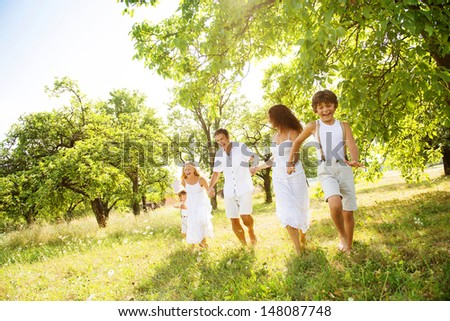 Happy young family spending time outdoor on a summer day #148087748