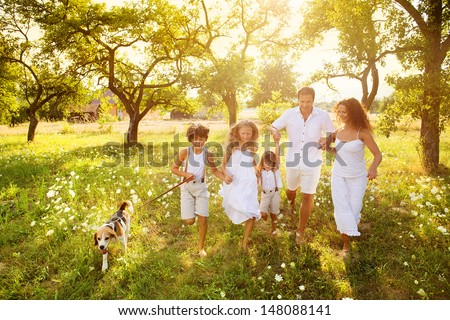 Happy young family spending time outdoor on a summer day - Shutterstock ID 148088141