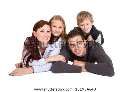Happy young family spending time together. Isolated on white