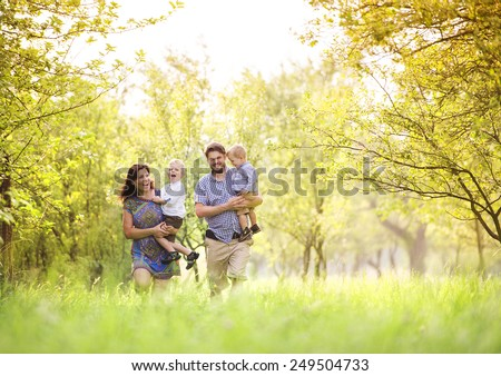 Happy young family spending time together outside in green nature. #249504733