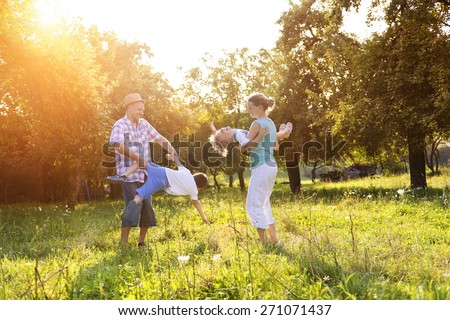 Happy young family spending time together outside in green nature. #271071437