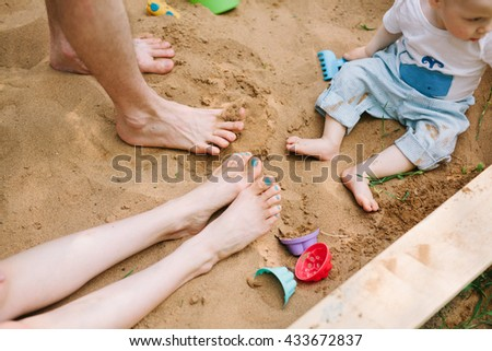Happy young family spending time together outside in green nature #433672837