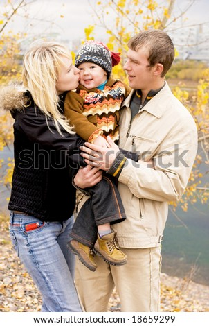 happy young family walk outdoor