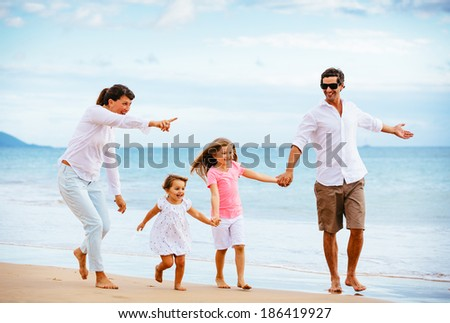 family walking on the beach at sunset Happy Family Lifestyle 186419927