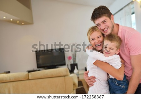 happy young family with kids in bright modern living room have fun