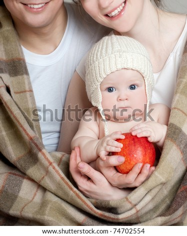 happy young family with kids in cozy plaid