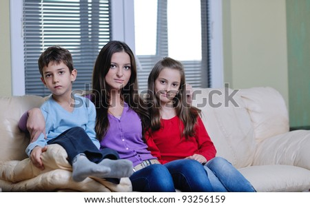happy young family with mom and kids have fun and play in modern new living room home indoor