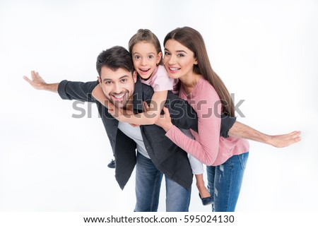 Happy young family with one child having fun together isolated on white