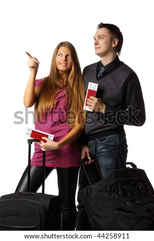 Happy young family with suitcases and tickets on a white background. Vacation.