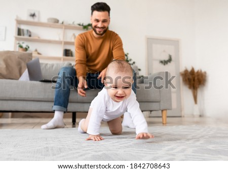 Happy Young Father Playing With Baby Toddler Having Paternity Leave, Bonding With Little Daughter At Home. Child Care, Cute Fatherhood Moments, Parenting Happiness. Selective Focus Stock photo ©