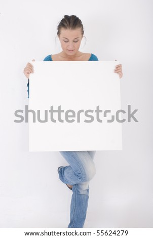 Happy young female holding big blank banner