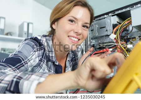 happy young female pc technician in class #1235030245