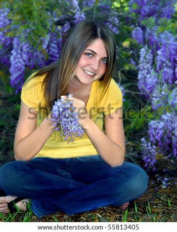 stock photo happy young female teen sits on the ground surrounded by wisteria blossoms she holds one grape 55813405 School uniforms | Teen Opinion Essay