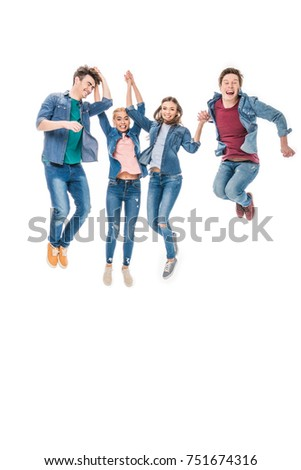 happy young friends holding hands and jumping together isolated on white #751674316