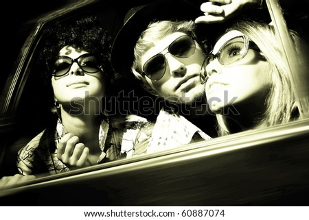 Happy young friends in the car