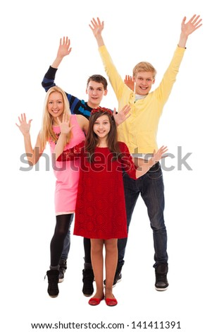 Happy young friends with their hands up