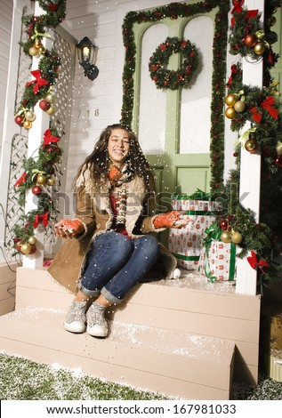 happy young girl at home decorated on Christmas, bringing gifts to friends