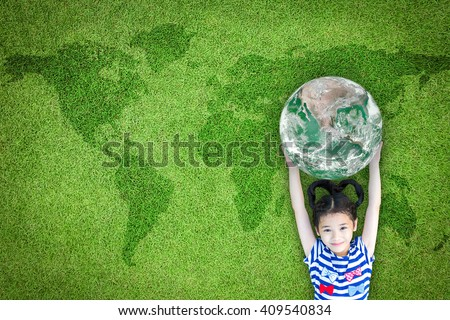 Happy young girl child kid raising green planet earth on grass ground lawn nature background: World sustainable environment CSR ESG eco bio friendly concept: Element of this image furnished by NASA