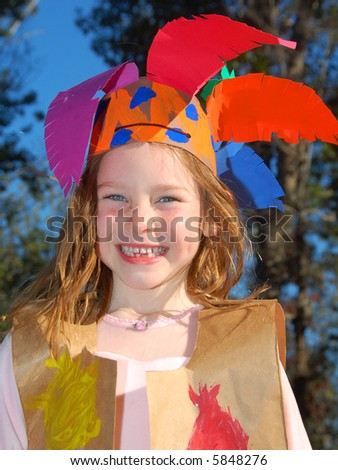 Happy Young Girl Dressed in Indian Costume for Thanksgiving Celebration