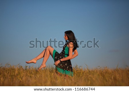 happy young girl in a field and a beautiful woman