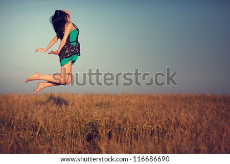 happy young girl in a field and a beautiful woman, levitation, flying from happiness